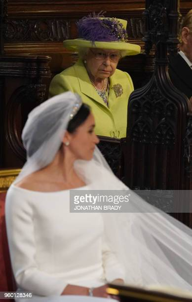 Britain's Queen Elizabeth II looks on during the wedding ceremony of Britain's Prince Harry, Duke of Sussex and US actress Meghan Markle in St...