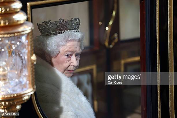 Britain's Queen Elizabeth II looks out from her carriage as she leaves after the State Opening of Parliament at the Houses of Parliament on May 27...
