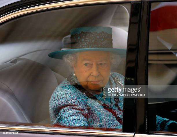 Britain's Queen Elizabeth II looks out of her car window as she arrives for the official reopening of Canada House the official home to the Canadian...