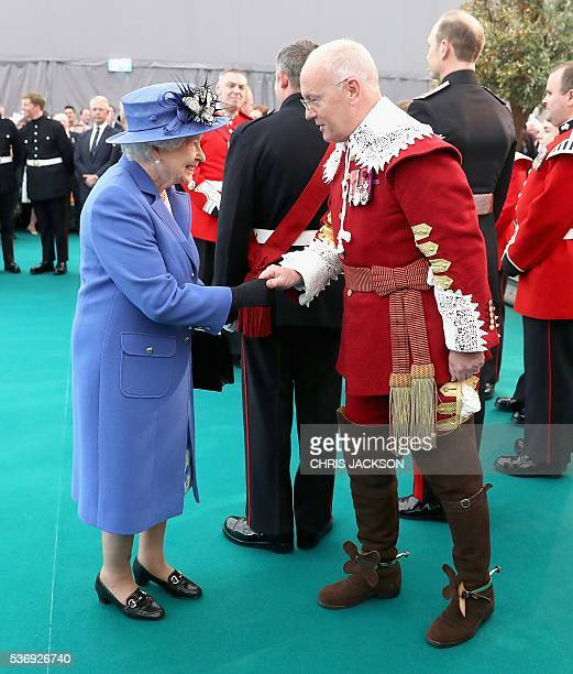Britain's Queen Elizabeth II meets a pikeman during a visit to the Honourable Artillery Company in London on June 1 2016 The engagement marks the...