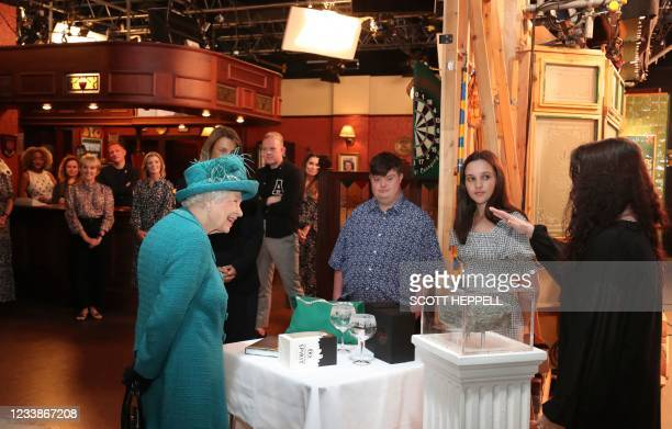 Britain's Queen Elizabeth II meets actors and members of the production team as she visits the set of the long running television series Coronation...