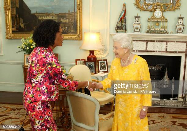 Britain's Queen Elizabeth II meets Aminatta Forna winner of the 2011 Commonwealth Writers Prize during an audience at Buckingham Palace central London