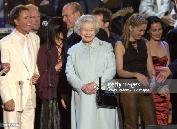 Britain's Queen Elizabeth II meets artist on stage in the gardens of Buckingham Palace after the second concert to commemorate the Golden Jubilee of...