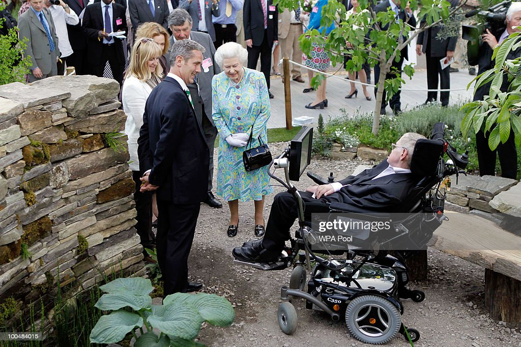 Britain's Queen Elizabeth II meets Britain's physicist Stephen Hawking as she visits a garden during the Press & VIP preview at The Chelsea Flower Show at Royal Hospital Chelsea on May 24, 2010 in London, England. The show, which has 600 exhibitors, opens to the public on Tuesday May 25.