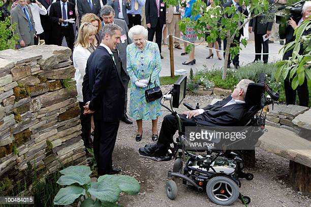 Britain's Queen Elizabeth II meets Britain's physicist Stephen Hawking as she visits a garden during the Press VIP preview at The Chelsea Flower Show...