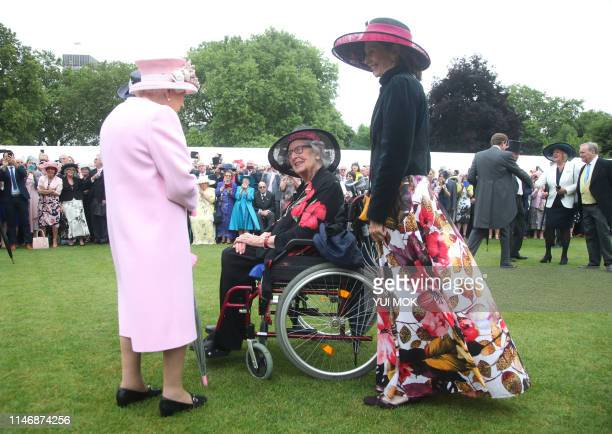 Britain's Queen Elizabeth II meets guests at the Queen's Garden Party in Buckingham Palace central London on May 29 2019
