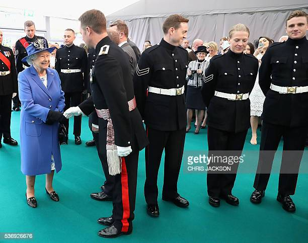 Britain's Queen Elizabeth II meets guests during a visit to the Honourable Artillery Company in London on June 1 2016 The engagement marks the Queen...