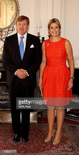 Britain's Queen Elizabeth II meets King WillemAlexander and his wife Queen Maxima of the Netherlands at Windsor Castle on July 10 2013 in Windsor...