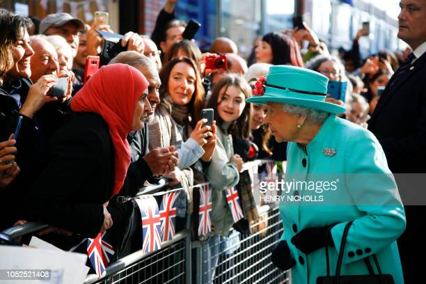TOPSHOT Britain's Queen Elizabeth II meets members of the public as she arrives at The Lexicon shopping centre during a visit to Bracknell west of...