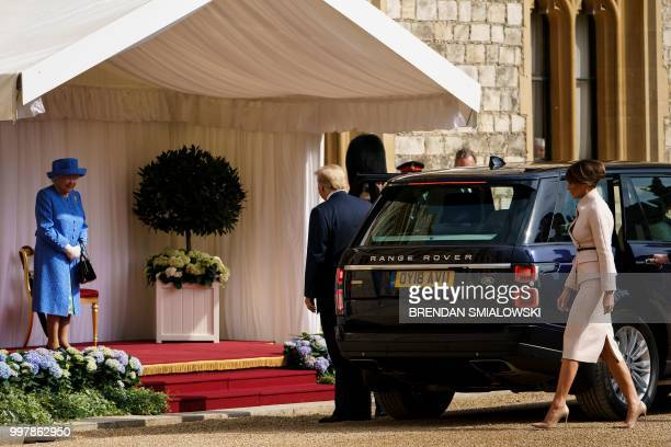 Britain's Queen Elizabeth II meets US President Donald Trump and US First Lady Melania Trump on their arrival at Windsor Castle in Windsor west of...