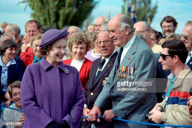 Britain's Queen Elizabeth II meets war veterans during annual Anzac Day ceremonies in Hobart on April 25, 1988. - April 25 marks the day in 1915 when...