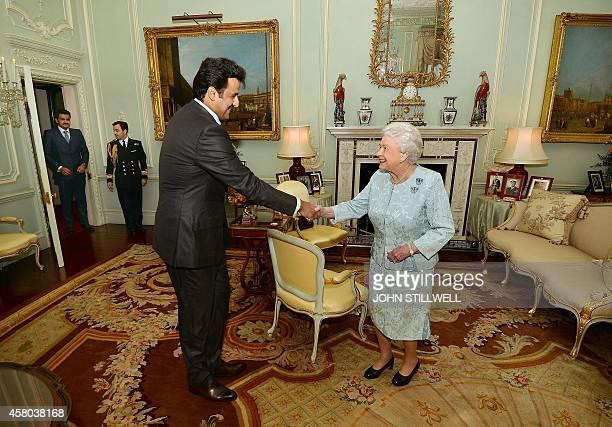 Britain's Queen Elizabeth II meets with the Emir of Qatar Sheikh Tamim Bin Hamad AlThani and his brother Sheikh Joaan bin Hamad bin Khalifa AlThani...