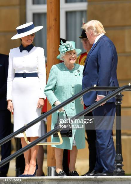 Britain's Queen Elizabeth II meets with US President Donald Trump and US First Lady Melania Trump during a welcome ceremony at Buckingham Palace in...