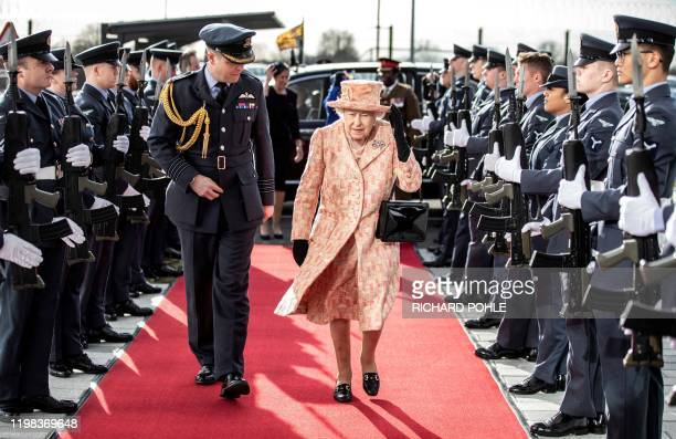 TOPSHOT Britain's Queen Elizabeth II pases a guard of honour as she arrives at Royal Air Force base Marham eastern England on February 3 to inspect...