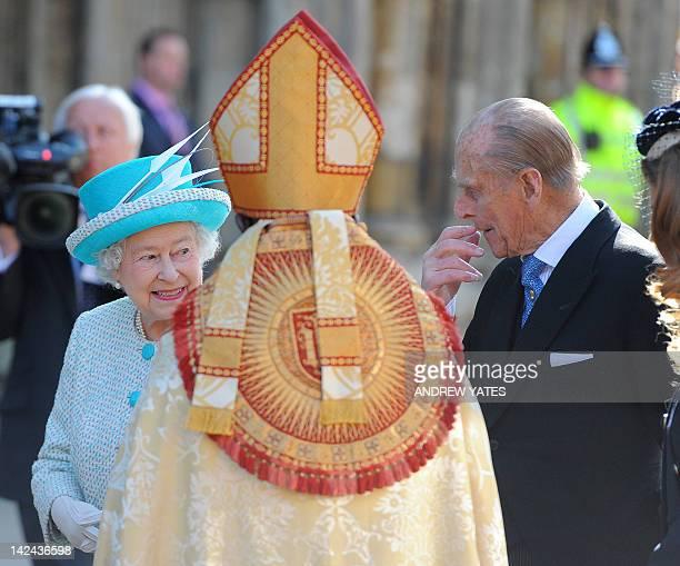 Britain's Queen Elizabeth II passes Archbishop of York John Sentamu with Prince Philip Duke of Edinburgh as she arrives for the Royal Maundy Service...