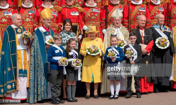 Britain's Queen Elizabeth II poses after taking part in the Royal Maundy Service at St George's Chapel in Windsor west of London on April 18 2019...
