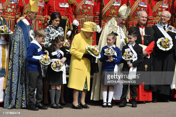 TOPSHOT Britain's Queen Elizabeth II poses after taking part in the Royal Maundy Service at St George's Chapel in Windsor west of London on April 18...