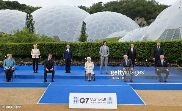 Britain's Queen Elizabeth II , poses for a family photograph with, from left, Germany's Chancellor Angela Merkel, President of the European...