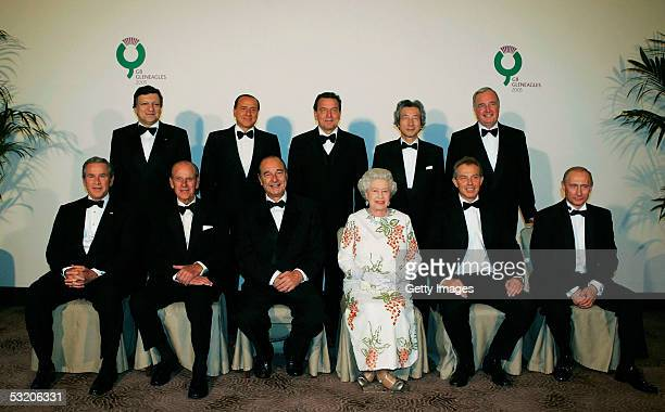 Britain's Queen Elizabeth II poses for a group photo with G8 leaders US President Bush Britain's Prince Philip French President Chirac Queen...