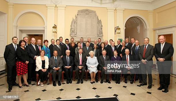 Britain's Queen Elizabeth II poses for a group photograph with Cabinet Secretary and Head of the Home Civil Service Sir Gus O'Donnell and Permanent...