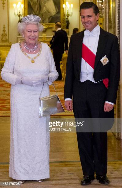 Britain's Queen Elizabeth II poses for a photograph with Mexican President Enrique Pena Nieto before a State Banquet at Buckingham Palace in London...