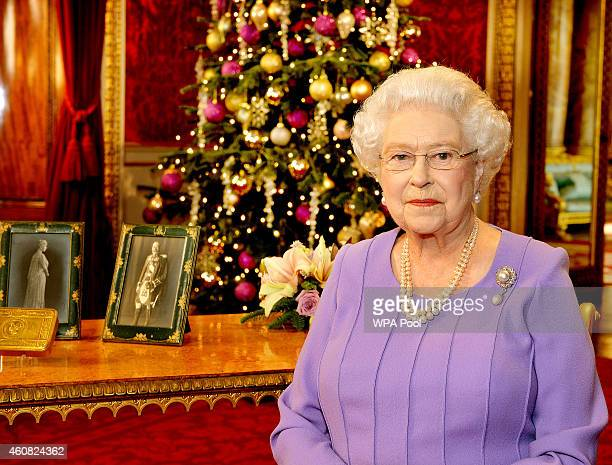 Britain's Queen Elizabeth II poses in the State Dining Room of Buckingham Palace after recording her Christmas Day television broadcast to the...