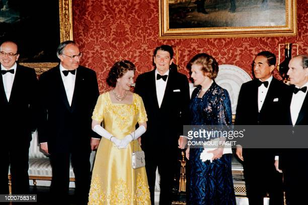 Britain's Queen Elizabeth II poses on September 6, 1984 at Buckingham Palace with Economic Summit leaders: French President François Mitterrand,...