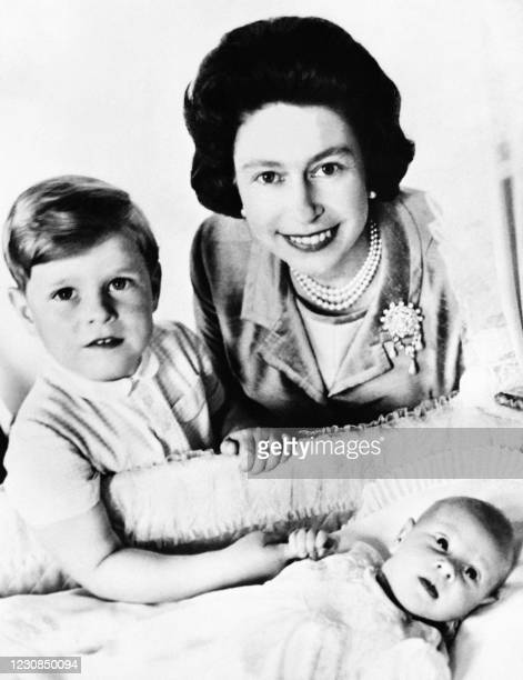Queen Elizabeth II poses with Prince Edward and Prince Andrew, 13 June 1964 in London.