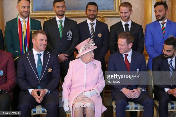 Britain's Queen Elizabeth II poses with the captains of the cricket teams participating in the ICC Cricket World Cup 2019 in the 1844 Room at...