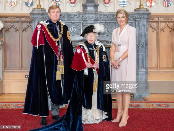 Britain's Queen Elizabeth II poses with with King WillemAlexander of the Netherlands and his wife Queen Maxima in St George's Hall at Windsor Castle...