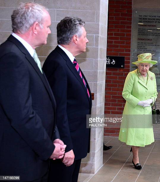 Britain's Queen Elizabeth II prepares to shake hands with Northern Ireland Deputy First Minister Martin McGuinness and First Minister Peter Robinson...