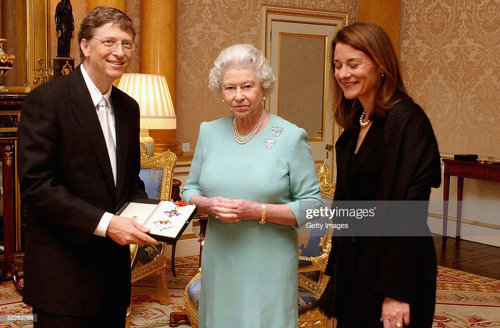 Britain's Queen Elizabeth II presents Microsoft tycoon Bill Gates with his honorary knighthood watched by his wife Melinda Gates on March 2, 2005 at Buckingham Palace in London, England. One of the richest men in the world, Gates cannot use the title 'Sir' as he is not a British citizen. He received the KBE insignia, in recognition of his charitable donations in Commonwealth countries.