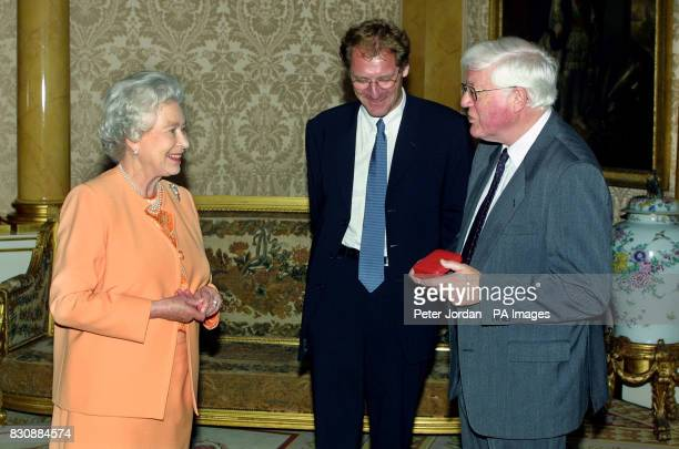 Britain's Queen Elizabeth II presents Peter Porter with her Gold Medal for Poetry during an audience at Buckingham Palace in London also attended by...