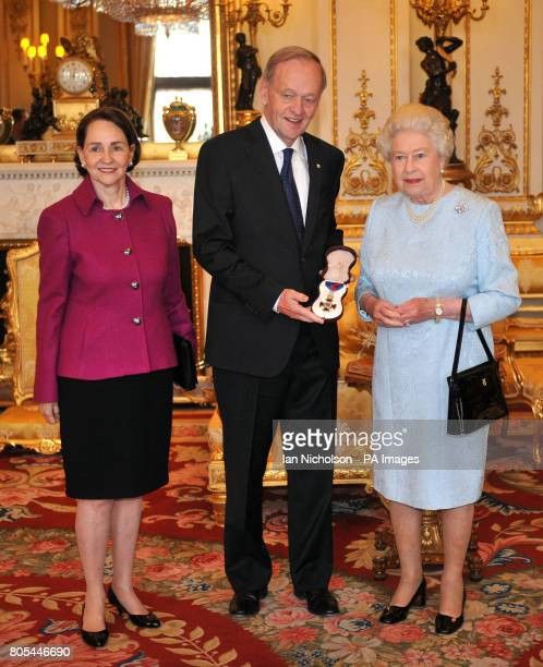 Britain's Queen Elizabeth II presents the Order of Merit to former Canadian Prime Minister Jean Chretien, accompanied by wife Aline at Buckingham...