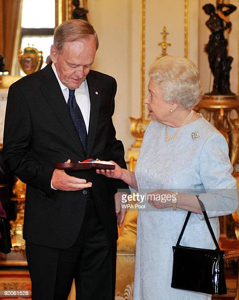 Britain's Queen Elizabeth II presents the Order of Merit to Former Canadian Prime Minister Jean Chretien at Buckingham Palace on October 20 2009 in...