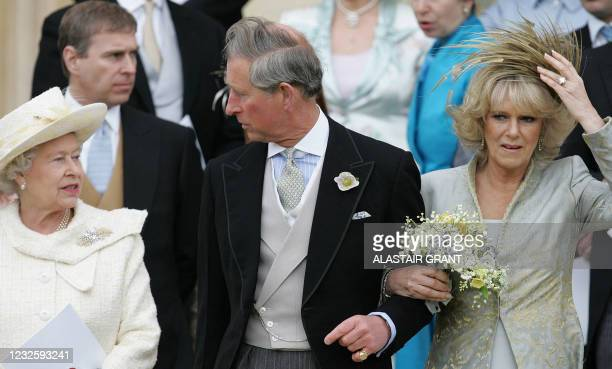 Britain's Queen Elizabeth II, Prince Charles and his bride Camilla, Duchess of Cornwall leave St George's Chapel in Windsor following the church...