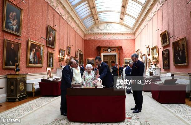 Britain's Queen Elizabeth II Prince Philip Duke of Edinburgh and King Felipe VI of Spain and Queen Letizia of Spain look at a display of Spanish...