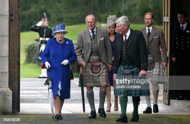 Britain's Queen Elizabeth II Prince Philip Duke of Edinburgh Sophie Countess of Wessex and Prince Edward Earl of Wessex walk together during a garden...
