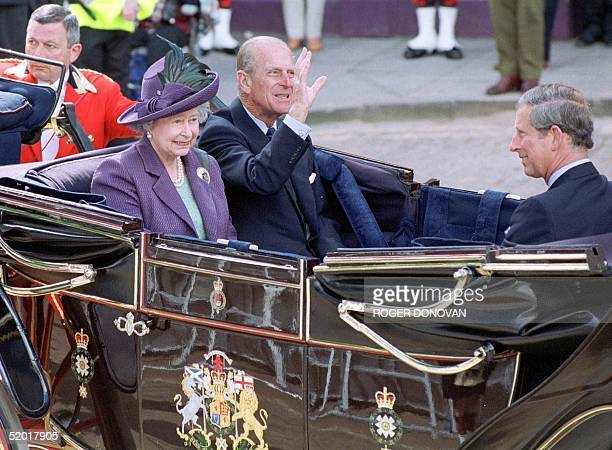 Britain's Queen Elizabeth II Prince Phillip and Prince Charles arrive for the State Opening of the Scottish Parliament in Edinburgh 01 July 1999