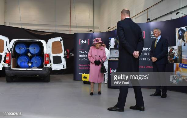 Britain's Queen Elizabeth II Prince William Duke of Cambridge and Dstl Chief Executive Gary Aitkenhead view a demonstration of a Forensic Explosives...