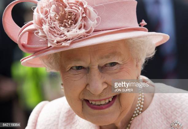 Britain's Queen Elizabeth II reacts after arriving by Royal Train at Liverpool Lime Street Station in Liverpool northwest England on June 22 2016 The...