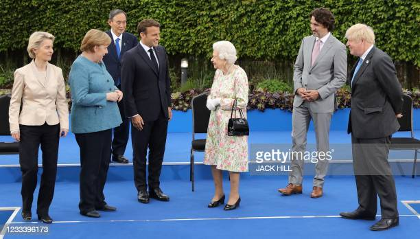 Britain's Queen Elizabeth II , reacts after posing for a family photograph with, from left, President of the European Commission Ursula von der...