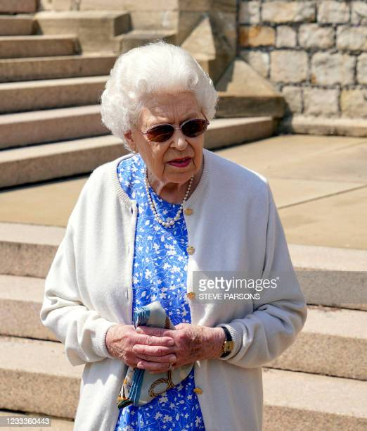Britain's Queen Elizabeth II reacts after she was presented with a Duke of Edinburgh rose, named in memory of her late husband Prince Philip, the...
