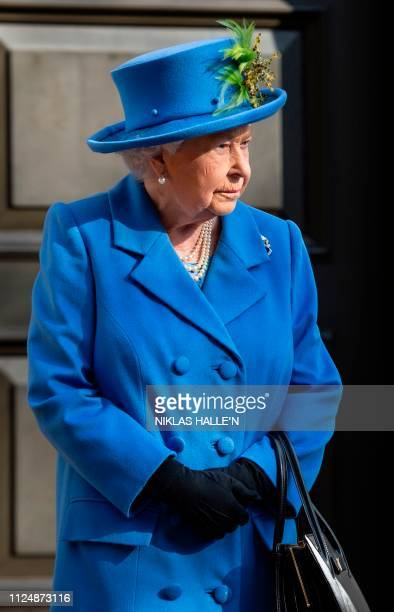 Britain's Queen Elizabeth II reacts as she attends an event to mark the centenary of GCHQ the UK's Intelligence Security and Cyber Agency at...
