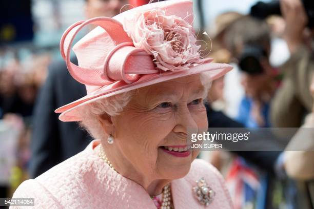 Britain's Queen Elizabeth II reacts as she is greeted by wellwishers after arriving by Royal Train at Liverpool Lime Street Station in Liverpool...