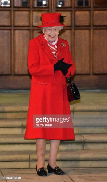 Britain's Queen Elizabeth II reacts as she waits to thank local volunteers and key workers for the work they are doing during the coronavirus...