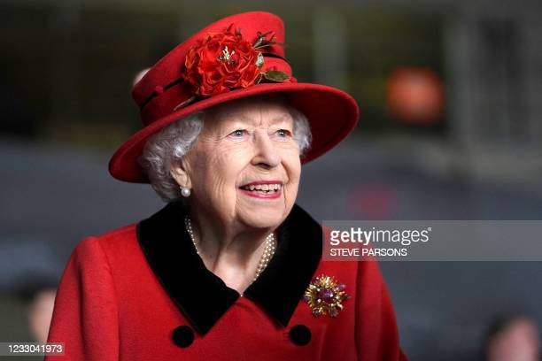Britain's Queen Elizabeth II reacts during her visit to the aircraft carrier HMS Queen Elizabeth in Portsmouth, southern England on May 22 ahead of...