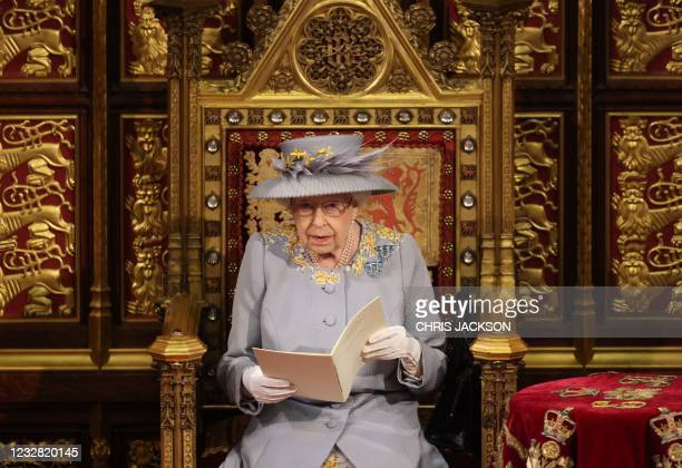 Britain's Queen Elizabeth II reads the Queen's Speech on the Sovereign's Throne in the House of Lords chamber during the State Opening of Parliament...
