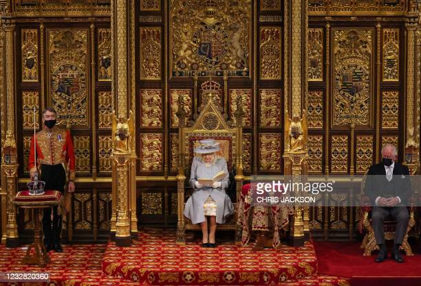 Britain's Queen Elizabeth II reads the Queen's Speech on the The Sovereign's Throne, as Britain's Prince Charles, Prince of Wales listens, in the...