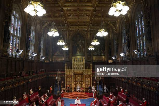 Britain's Queen Elizabeth II reads the Queen's Speech on the The Sovereign's Throne in a socially distanced House of Lords chamber, during the State...